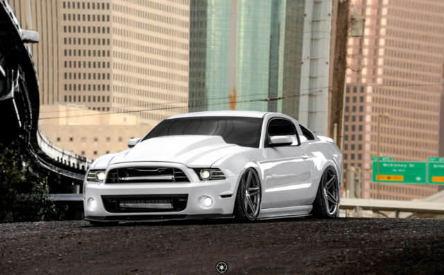 Bagged and Boosted S197 Mustang Showcasing Cowl Hood