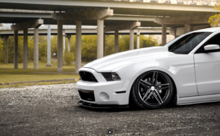Bagged and Boosted S197 Mustang Showcasing Vossen Wheels